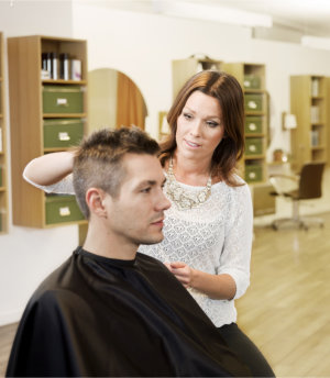 woman barber doing a haircut to client